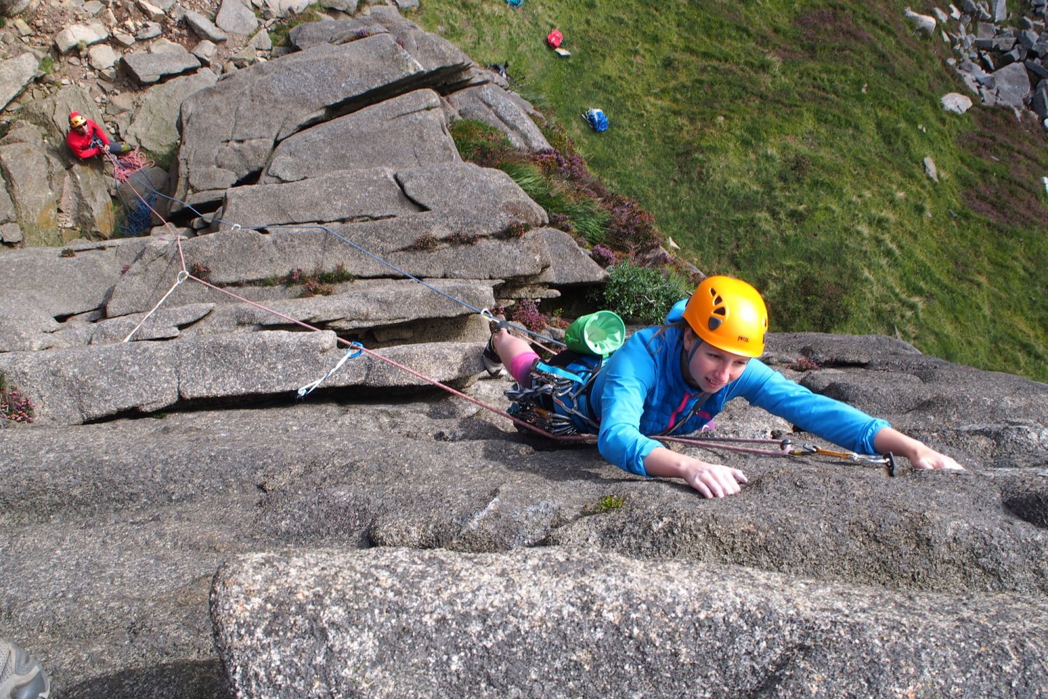 Woman lead climbing, Mourne Mountains, Northern Ireland